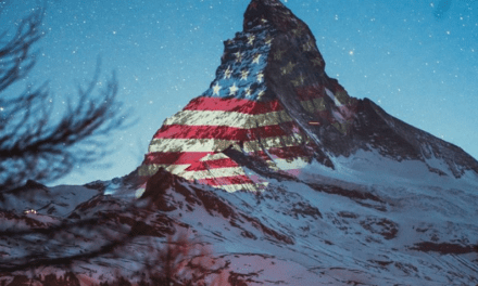 Swiss Village Projecting World Flags Onto Mountaintop In Pandemic Solidarity